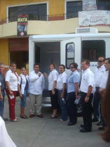 Members of the Huejutla club hand off the keys to the trailer to the medical clinic.