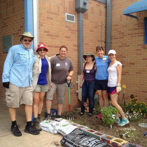 ACRC Members work to weed and mulch flower beds at Pecan Springs Elementary.
