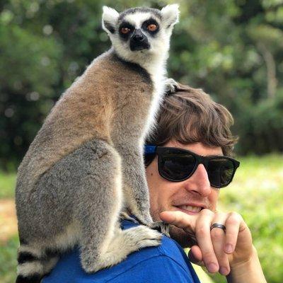 chris essig with lemur on shoulder